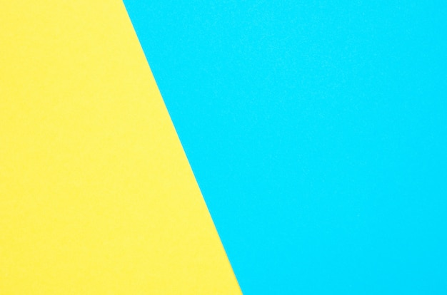 Geometrische achtergrond van papier. gele en turkooise kleurendocument textuurachtergrond.