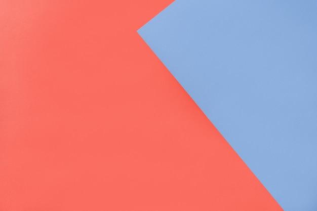 Geometrische achtergrond van twee papieren met blauwe en oranje kleur.