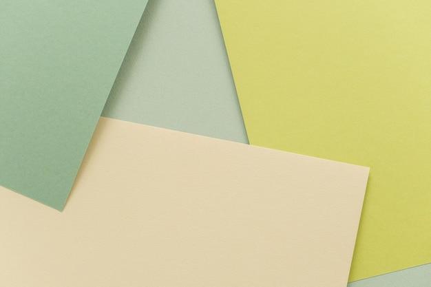 Geometrische papier achtergrond, textuur van groene tinten. achtergrond voor uw ontwerp. lente pastelkleuren