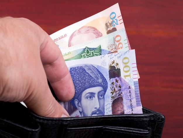 Georgisch geld lari in de zwarte portemonnee