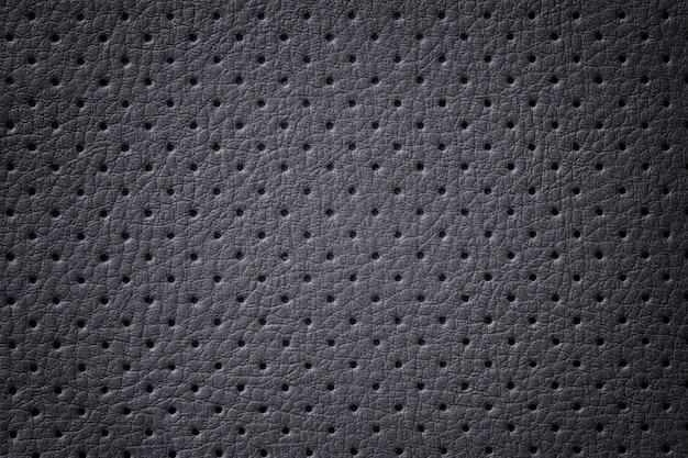Geperforeerde donkergrijze lederen textuur achtergrond