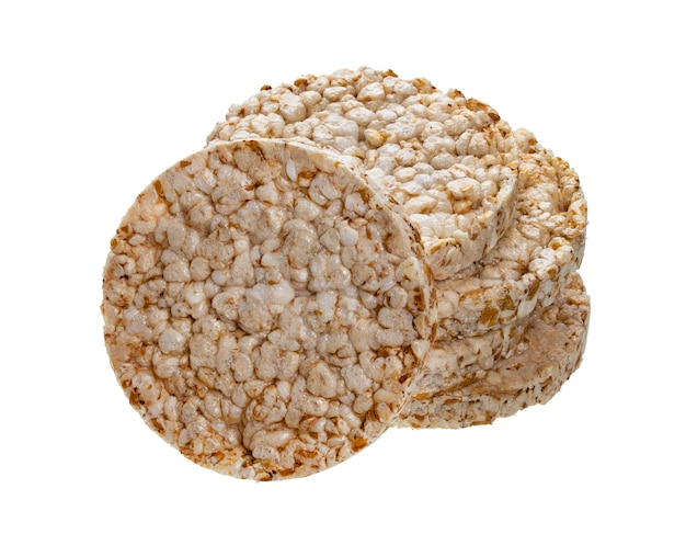 Gepuft rijstbrood dat op witte achtergrond, krokante ronde de rijstwafels van het dieet wordt geïsoleerd