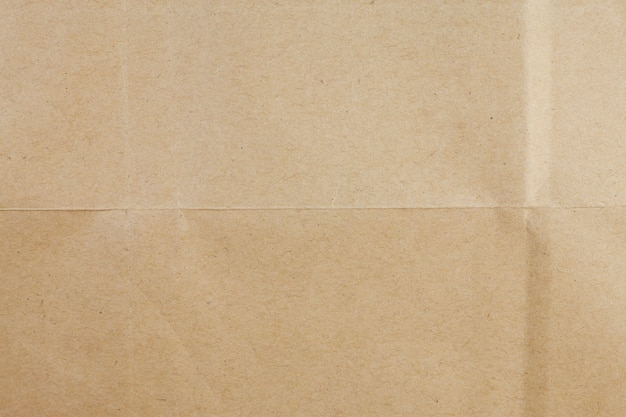 Gerecycleerde bruine papieren achtergrond.