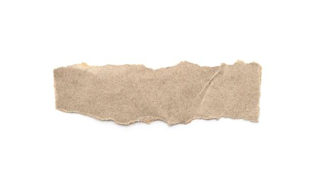 Gerecycleerde papieren ambachtelijke stok op een witte achtergrond. bruine papieren gescheurde of gescheurde stukjes papier