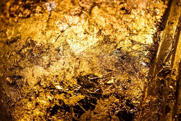 Gerimpelde gouden gestructureerde achtergrond