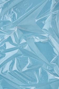 Gerimpelde vershoudfolie, blauwe vinyl abstracte achtergrond. minimaal, plat gelegd.
