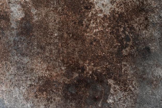 Geroest op het oppervlak van het oude ijzer, verslechtering van het staal, verval en ruwe grunge. donkere patina koper metalen achtergrondstructuur. vintage-effect. ã¢â€â‹textuur achtergrond