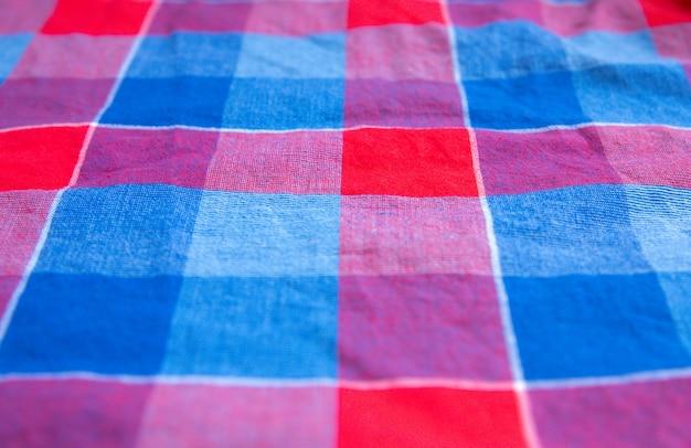 Geruite doek textuur. vierkantjes op textiel. natuurlijke stoffen achtergrond.