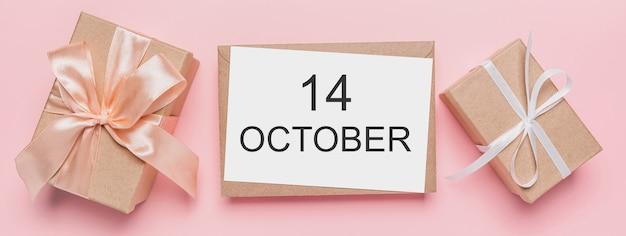 Geschenken met notitiebrief op geïsoleerde roze ruimte, liefde en valentijnskaartconcept met tekst 14 oktober