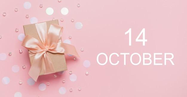 Geschenken op roze achtergrond, liefde en valentijn concept met tekst 14 oktober