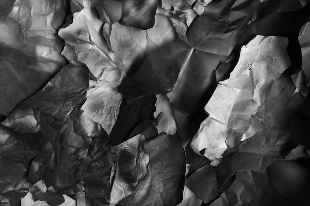 Gescheurd gekleurd papier, textuur, achtergrond, zwart-wit