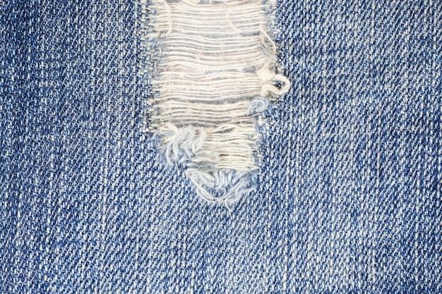 Gescheurde denim jeans textuur.