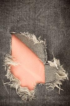 Gescheurde denim vintage textuur achtergrond. Premium Foto