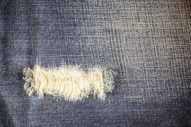 Gescheurde denim vuile jeanstextuur