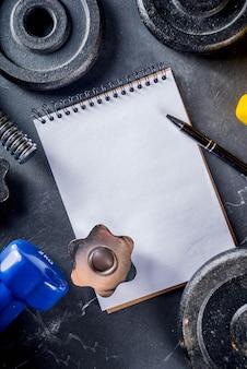 Geschiktheidshulpmiddelen en domoren met leeg notitieboekje