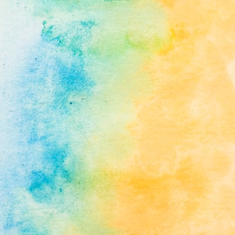 Geschilderd geweven document met blauwe en gele waterkleurachtergrond