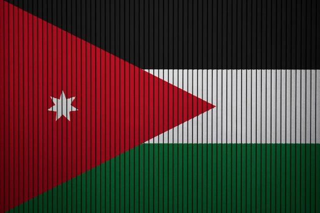 Geschilderde nationale vlag van jordanië op een betonnen muur