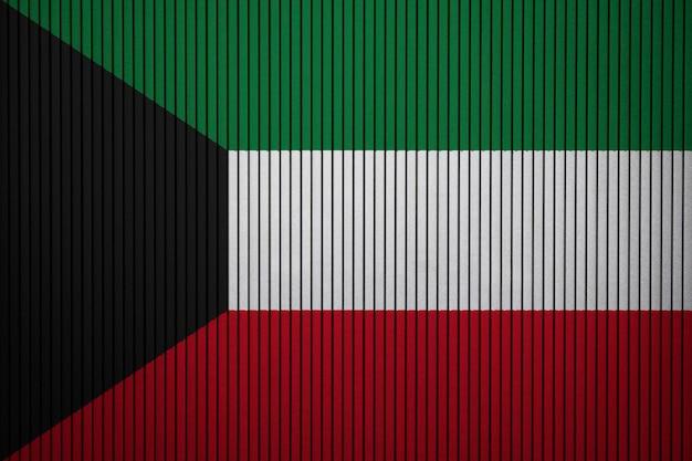 Geschilderde nationale vlag van koeweit op een betonnen muur