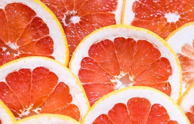 Gesneden grapefruit als achtergrond