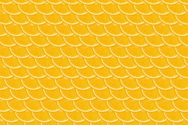 Gesneden oranje patroon. heldere plat lag achtergrond. vers sappig fruit, bron van vitamine c.