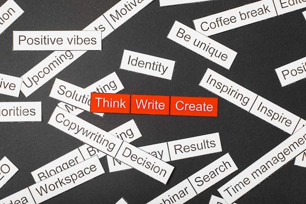Gesneden papieren inscriptie denken, schrijven, creëren op een rode achtergrond