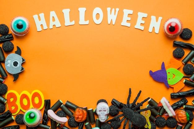 Gestileerde halloween bijschrift en snoepjes