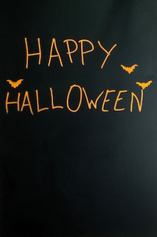Gestileerde happy halloween bijschrift met vleermuizen