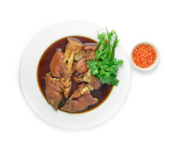 Gestoofde varkensvleespoot in zoet bruin soep aziatisch voedsel