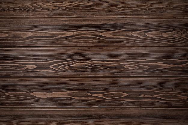 Gestructureerd houtoppervlak met mooie structuur van hout. natuurlijke achtergrond van lariksborden.