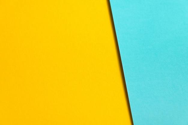 Gestructureerde achtergrond van blauw en geel gekleurd papier.