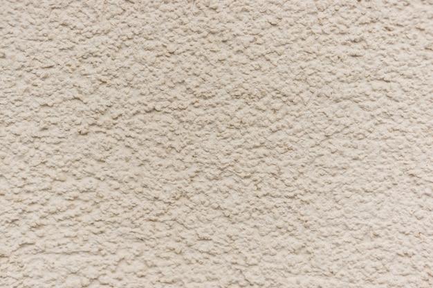 Getextureerde beige muur achtergrond