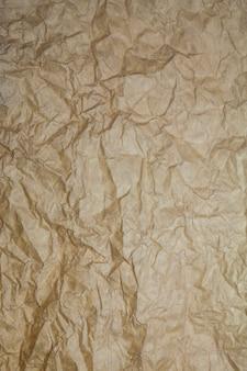 Getextureerde bruine papieren achtergrond.