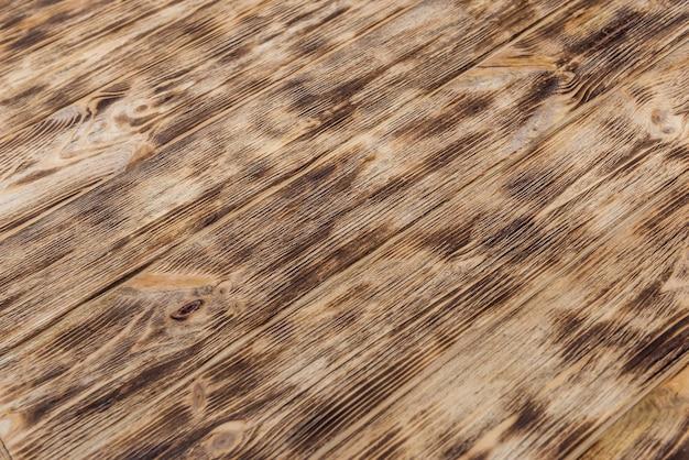 Getextureerde houten plank gebruikt als achtergrond close-up