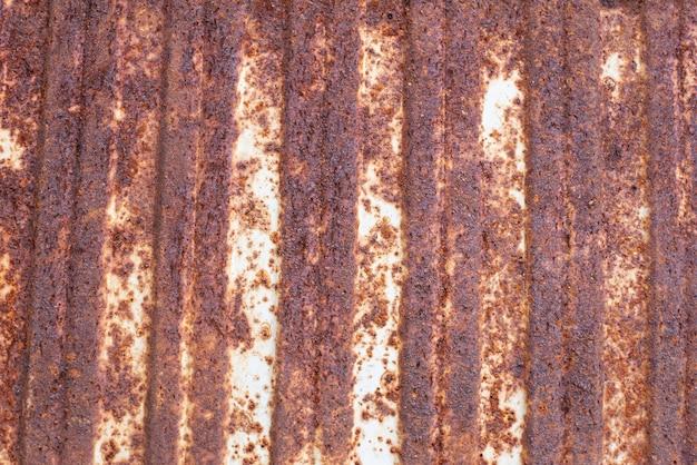 Getextureerde roestige metalen roodbruine achtergrond