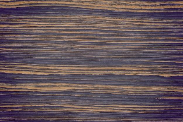 Getinte houten muur achtergrond of textuur