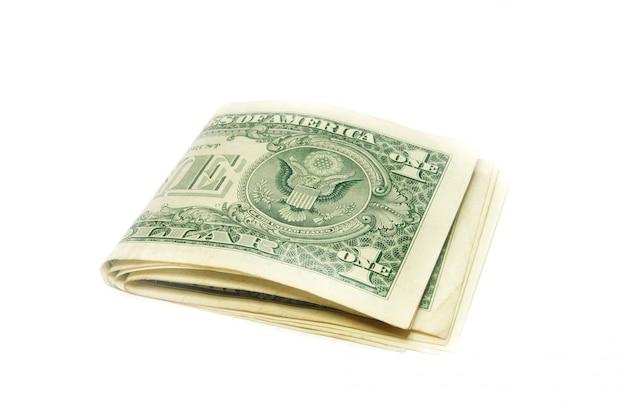 Gevouwen amerikaanse dollarbiljetten geïsoleerd