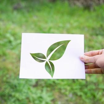 Gewas hand met eco bladeren symbool