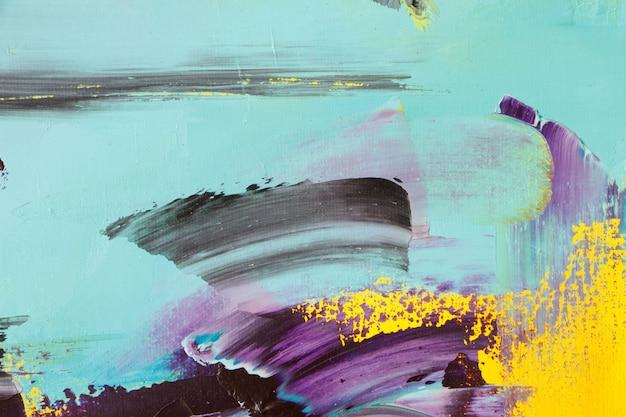 Geweven achtergrond van olieverf in gele en blauwe tinten, selectieve aandacht