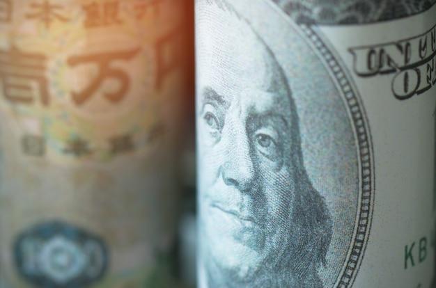 Gezichten van amerikaanse dollarleider, japanse yen, bankbiljettenvaluta's van landen