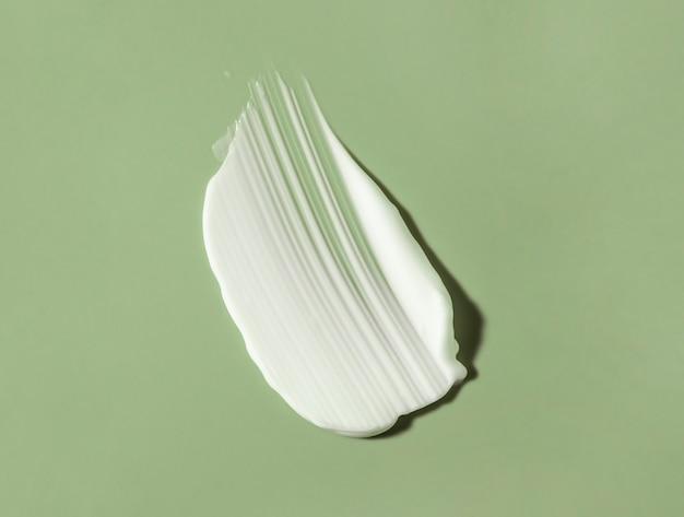 Gezichts- of lichaamscrème haarbalsem of balsem groene salie achtergrond
