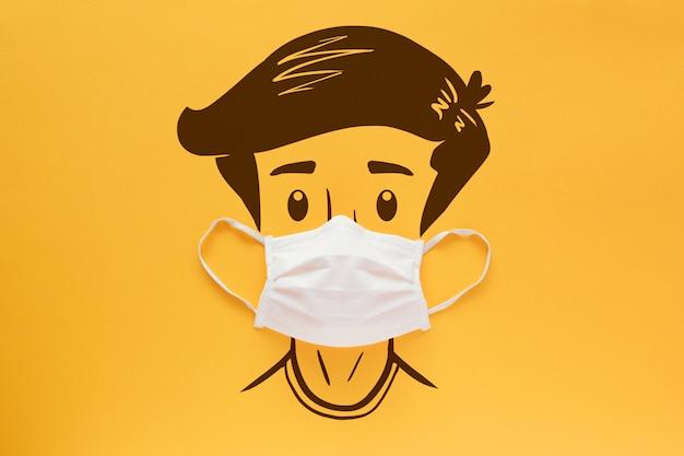 Gezichtsmasker op het gezicht van een getekend jongen op een gele achtergrond