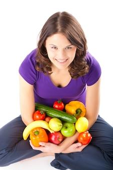 Gezonde voeding - jonge vrouw met fruit