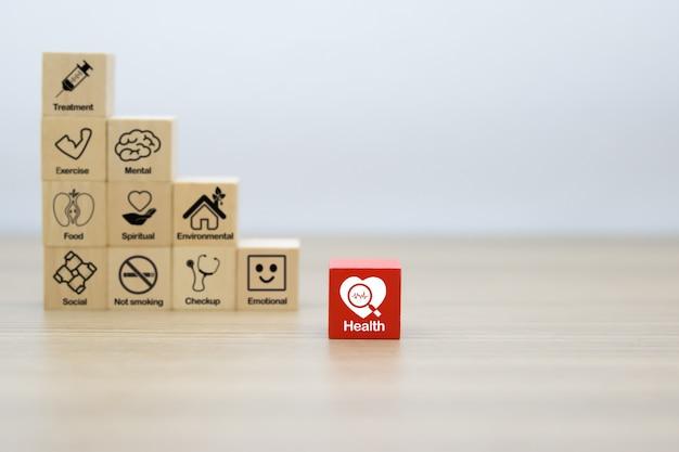Gezondheidsbevordering grafisch pictogram op houten blok.