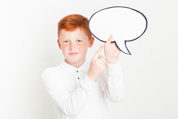 Ginger boy holding tekstballon