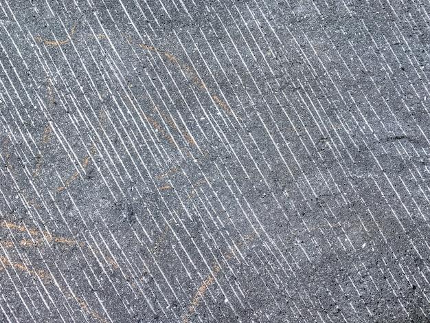 Glad oppervlak van de oude grijze steen in een sectie. oude achtergrond.