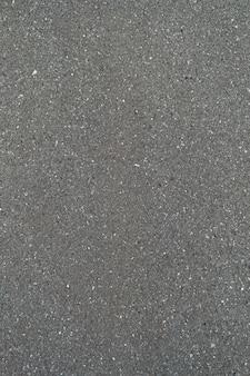 Gladde asfaltweg textuur van zwart ontwerppatroon, bovenaanzicht achtergrond.