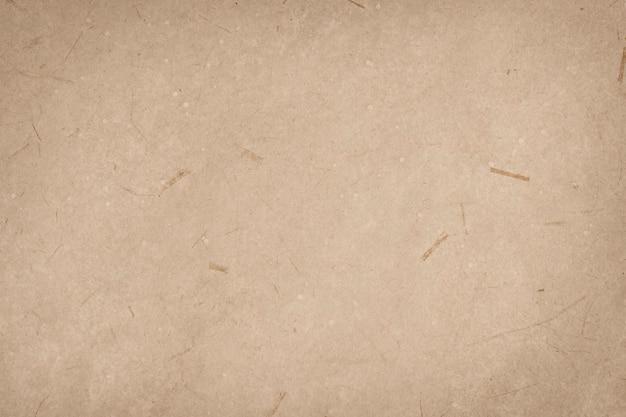Gladde bruine papieren getextureerde achtergrond