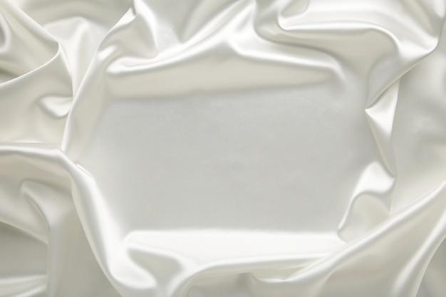 Gladde elegante witte zijde kan als achtergrond worden gebruikt.