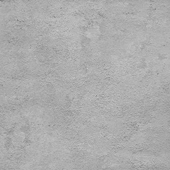 Gladde grijze gepleisterde muur