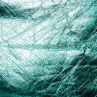 Glanzend blauw blad verfrommeld bladgoud